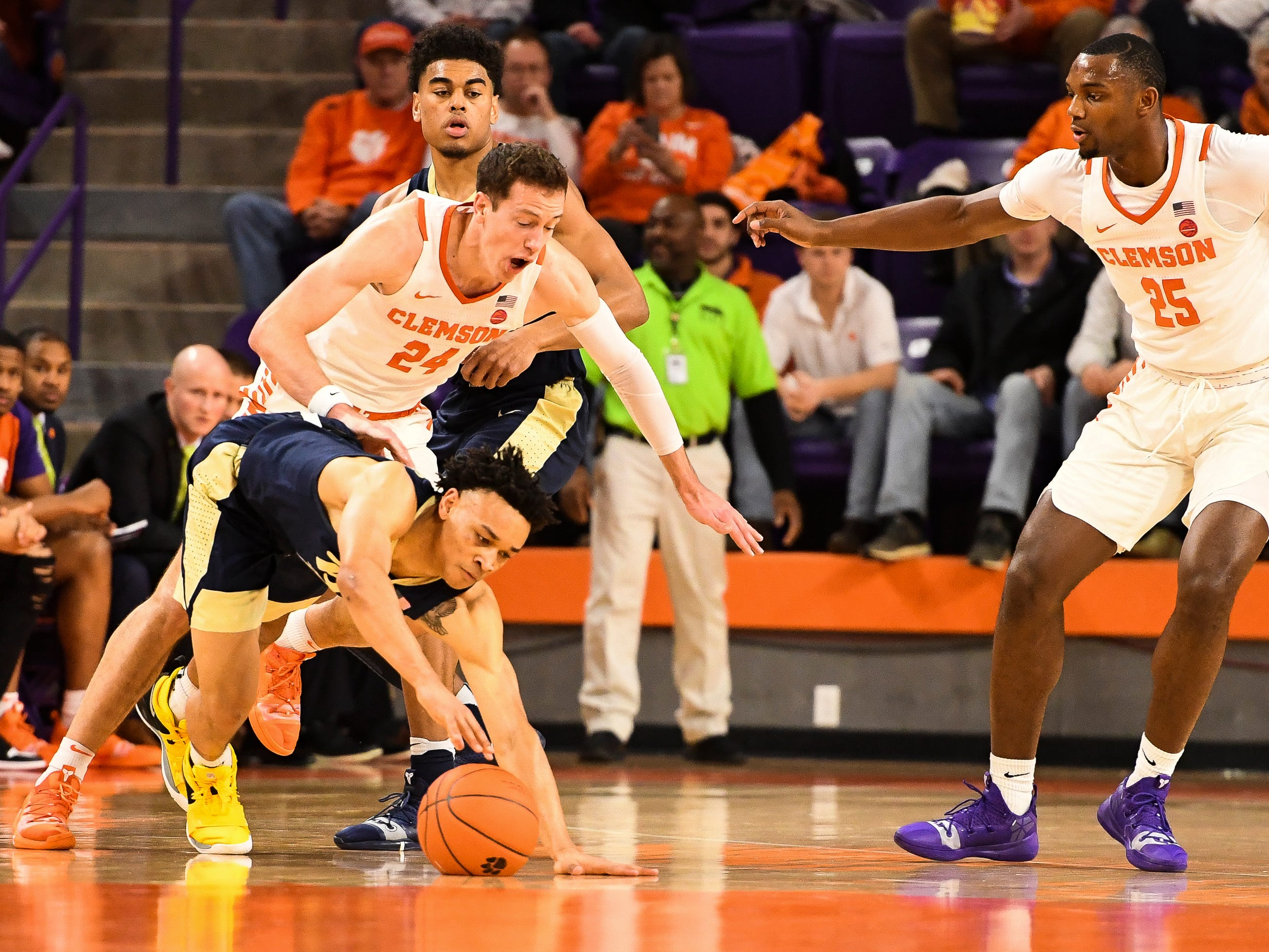 PittsburghÕs Trey McGowens (2) attempts to recover the ball after a fight for possession with Clemson forward David Skara (24) at Littlejohn Stadium on Tuesday, Jan. 29, 2019.