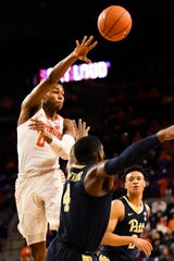 Clemson guard Clyde Trapp (0) throws the ball as PittsburghÕs Jared Wilson-Frame (4) and Trey McGowens (2) defend at Littlejohn Stadium on Tuesday, Jan. 29, 2019.