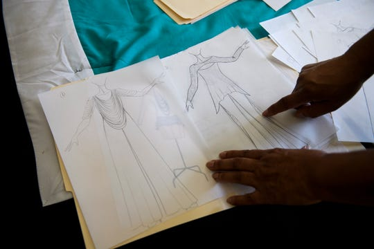 Kitty Black Perkins, former chief fashion designer for Barbie during a 28-year career at Mattel, shows sketches of dresses she has designed on Friday, Jan. 25, 2019.