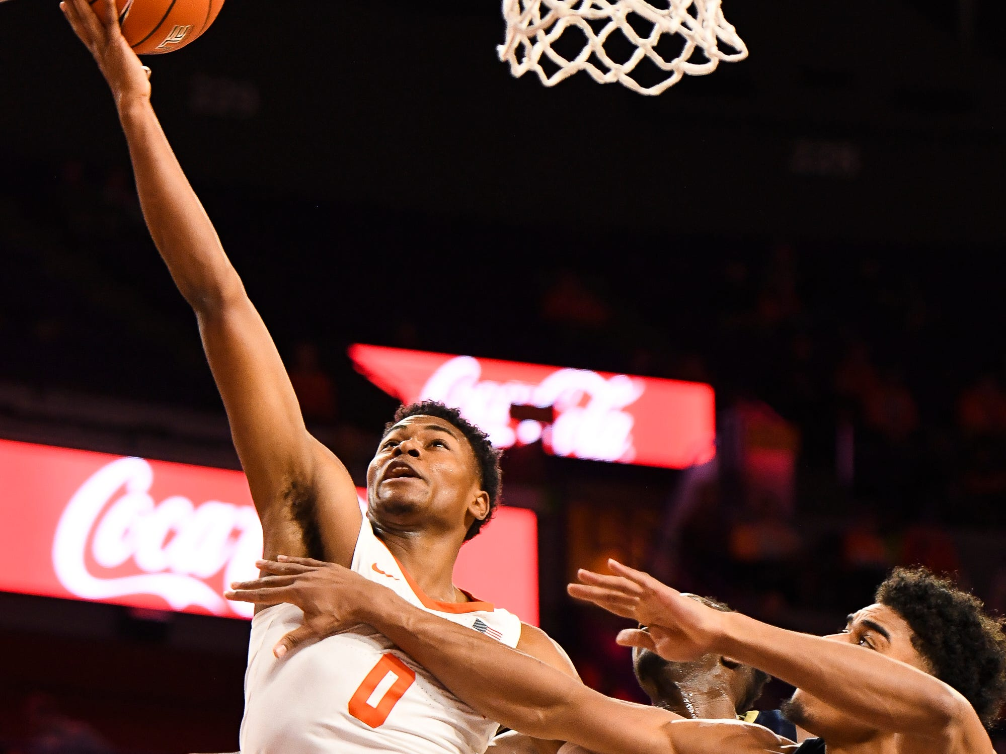 Clemson guard Clyde Trapp (0) attempts to shoot the ball as PittsburghÕs Sidy NÕDir (11) and Malik Ellison (3) defend at Littlejohn Stadium on Tuesday, Jan. 29, 2019.