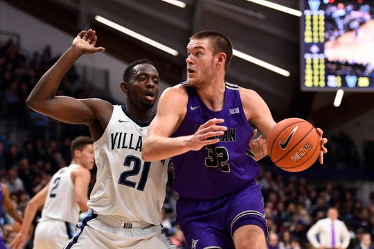 Nov 17, 2018; Villanova, PA, USA; Furman Paladins forward Matt Rafferty (32) works the ball past Villanova Wildcats forward Dhamir Cosby-Roundtree (21) during the first half at Finneran Pavilion. Mandatory Credit: Derik Hamilton-USA TODAY Sports
