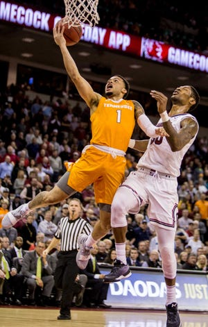 Tennessee Volunteers guard Lamonte Turner (1) drives around South Carolina Gamecocks forward Chris Silva (30) in the first half at Colonial Life Arena Tuesday night in Columbia.