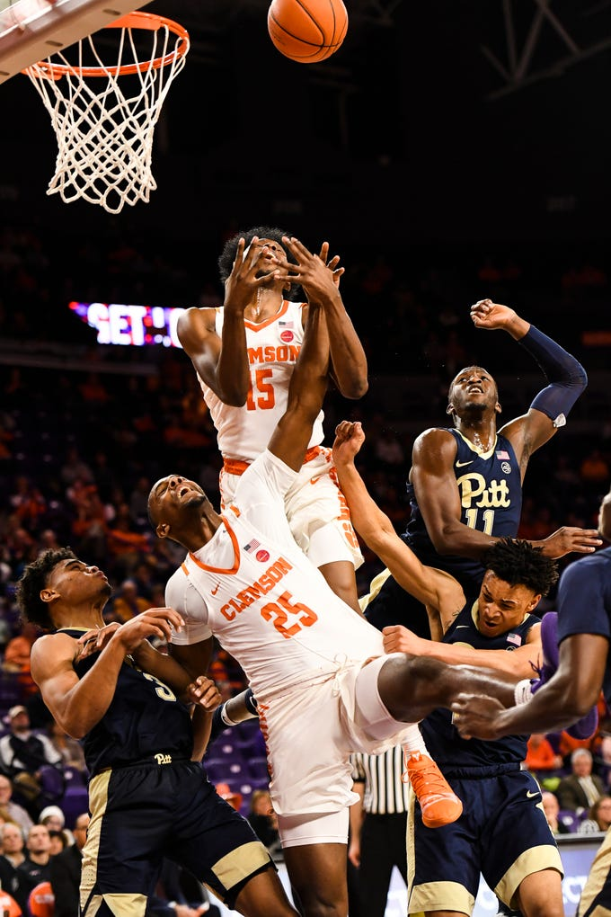 Clemson guard John Newman III (15) and forward Aamir Simms (25) attempts to grab possession of the rebound during their game against Pittsburgh at Littlejohn Stadium on Tuesday, Jan. 29, 2019.