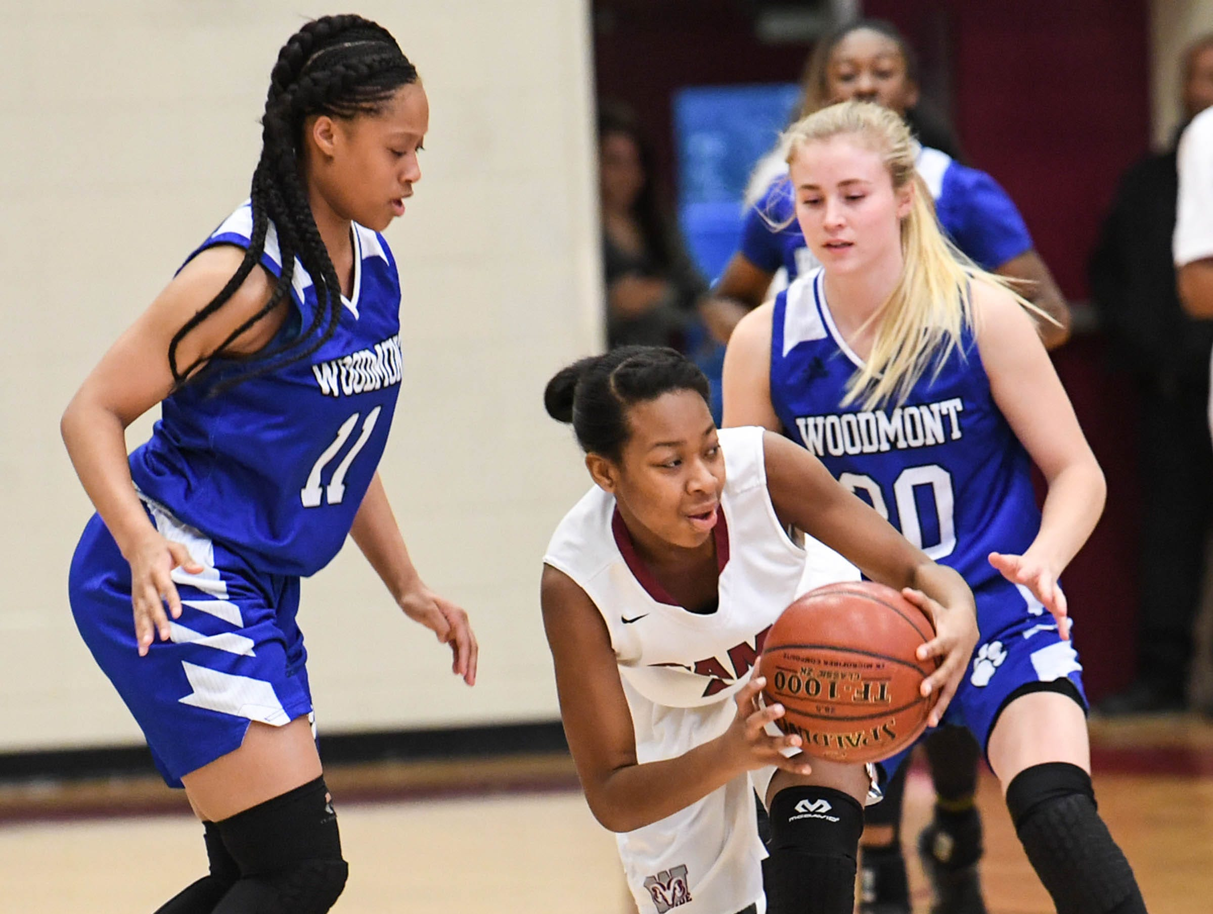 Woodmont senior Xan Rowland(20), right, and Kitara Henry(33) pressure Westside senior Chelsea Adger (5), middle, during the first quarter at Westside High School in Anderson on Tuesday.