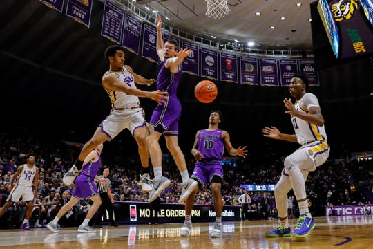 Dec 21, 2018; Baton Rouge, LA, USA; LSU Tigers guard Tremont Waters (3) passes the ball to forward Kavell Bigby-Williams (11) around Furman Paladins forward Matt Rafferty (32) in the second half at Maravich Assembly Center. Mandatory Credit: Stephen Lew-USA TODAY Sports