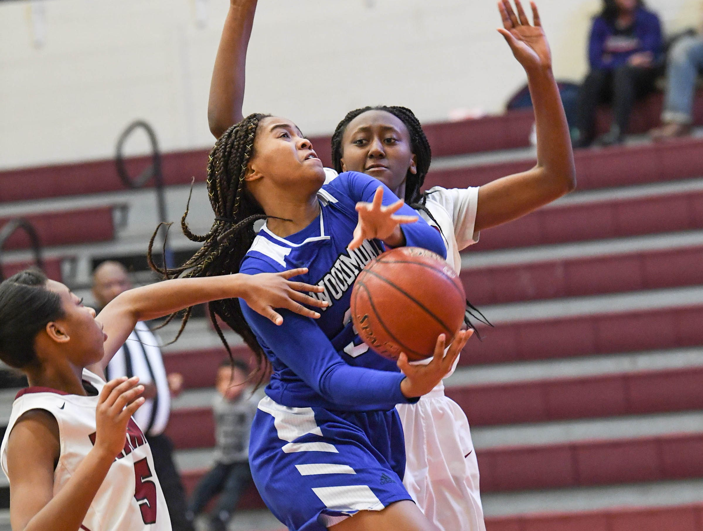 Woodmont senior Kitara Henry (33) shoots near Westside junior Keyshuna Fair (25), right, and Chelsea Adger (5), left, during the first quarter at Westside High School in Anderson on Tuesday.