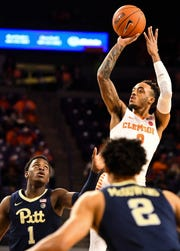Clemson guard Marcquise Reed (2) attempts to shoot the ball as PittsburghÕs Xavier Johnson (1) and Trey McGowens (2) defend at Littlejohn Stadium on Tuesday, Jan. 29, 2019.