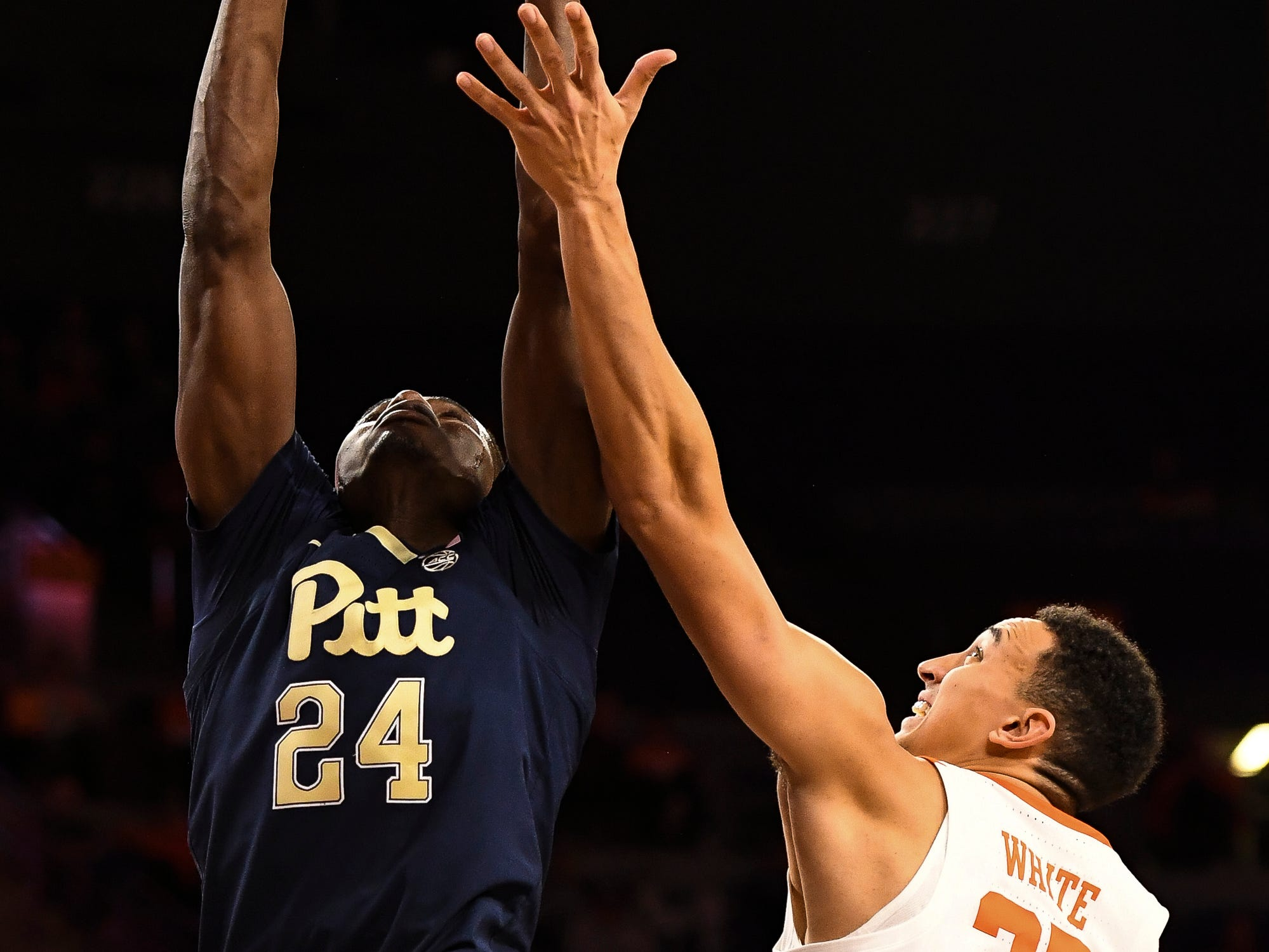 PittsburghÕs Samson George (24) attempts to grab the rebound away from Clemson forward Aamir Simms (25) at Littlejohn Stadium on Tuesday, Jan. 29, 2019.