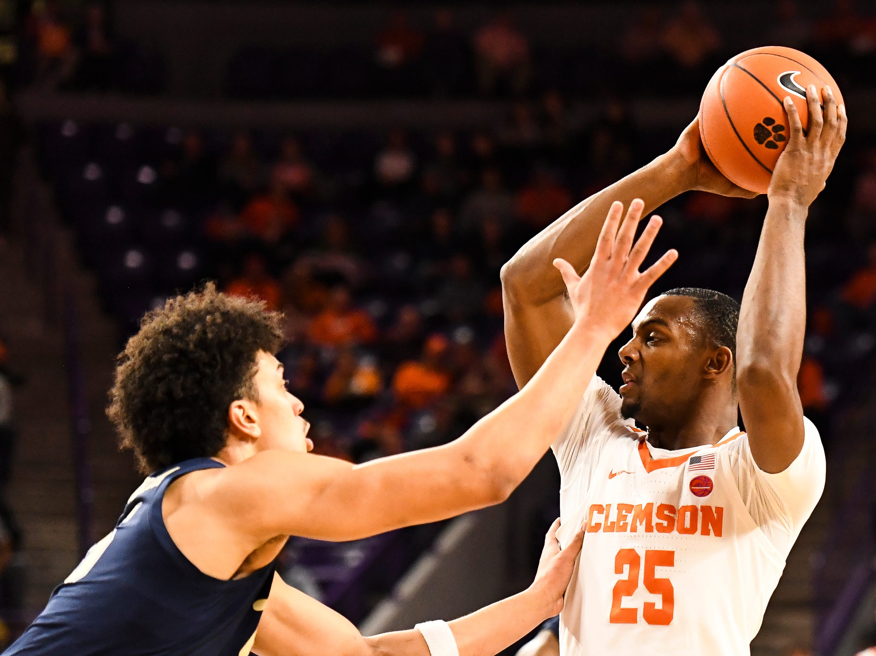 Clemson forward Aamir Simms (25) searches for an open teammate to throw the ball to as PittsburghÕs Keen Chuckwuka (15) defends at Littlejohn Stadium on Tuesday, Jan. 29, 2019.