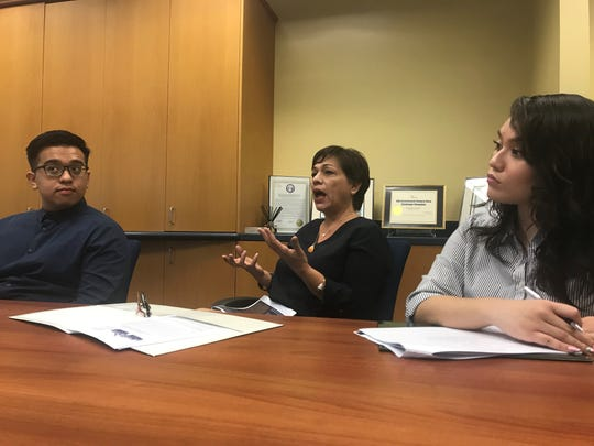 University of Guam Assistant Professor Gena Rojas responds to questions during a press conference Jan. 30 regarding a report on Guam's corruption perception. Rojas contributed to the report.