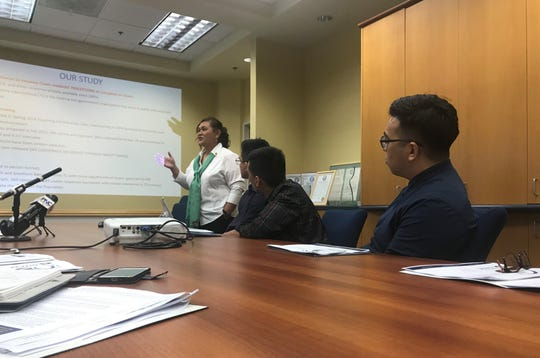 University of Guam Professor Maria Ruane presents her research regarding Guam residents' perception of corruption in the government.