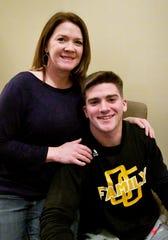 Oak Grove quarterback John Rhys Plumlee with his mom Lori Plumlee.