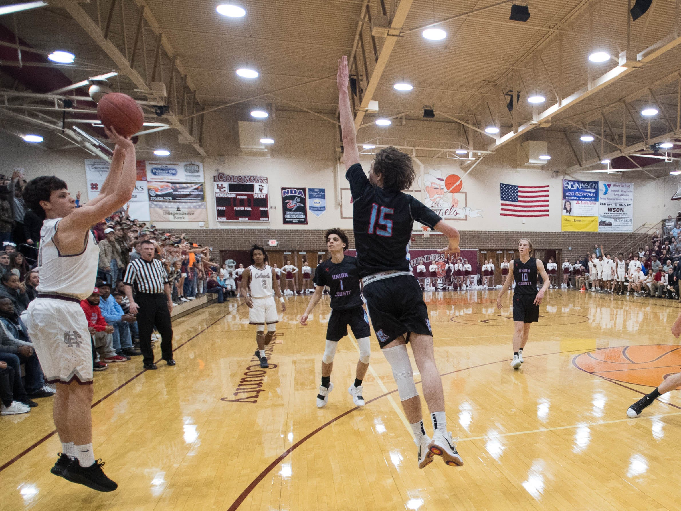 Henderson's Corey Stewart (1) takes a three point shoot as district rivals Union County Braves play the Henderson County Colonels at Colonel Gym in Henderson Tuesday, January 29, 2019.