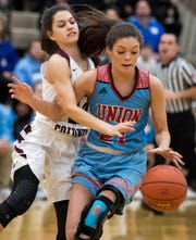 Courtlyn Beaven (21) battles defensive pressure from Henderson County's Katie Rideout (10) as district rivals Union County Bravettes play the Henderson County Lady Colonels at Colonel Gym in Henderson Tuesday, January 29, 2019.