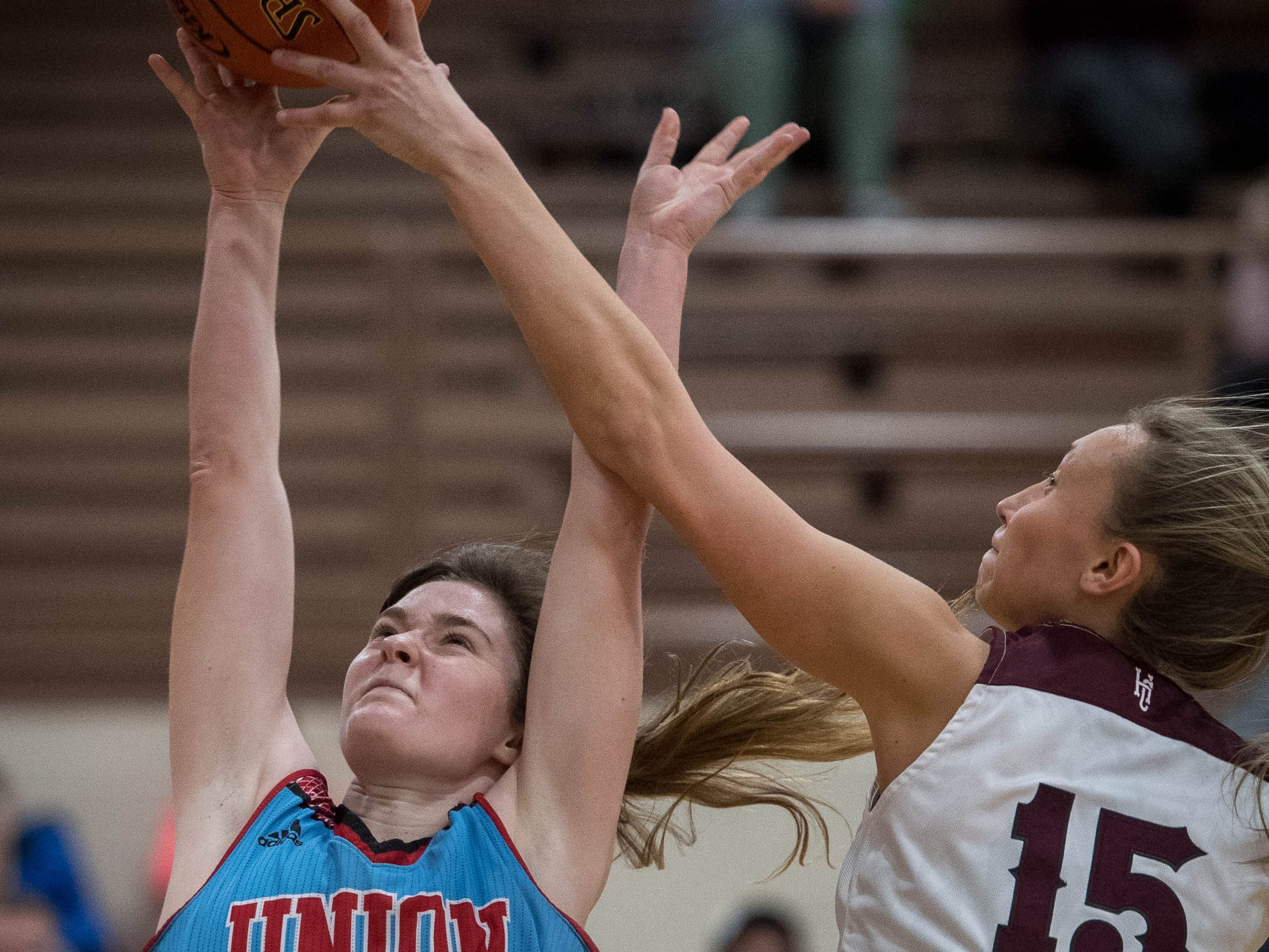 Henderson County's Alyssa Dickson (15) goes for a block as Jralee Roberson (22) shoots as district rivals Union County Bravettes play the Henderson County Lady Colonels at Colonel Gym in Henderson Tuesday, January 29, 2019.