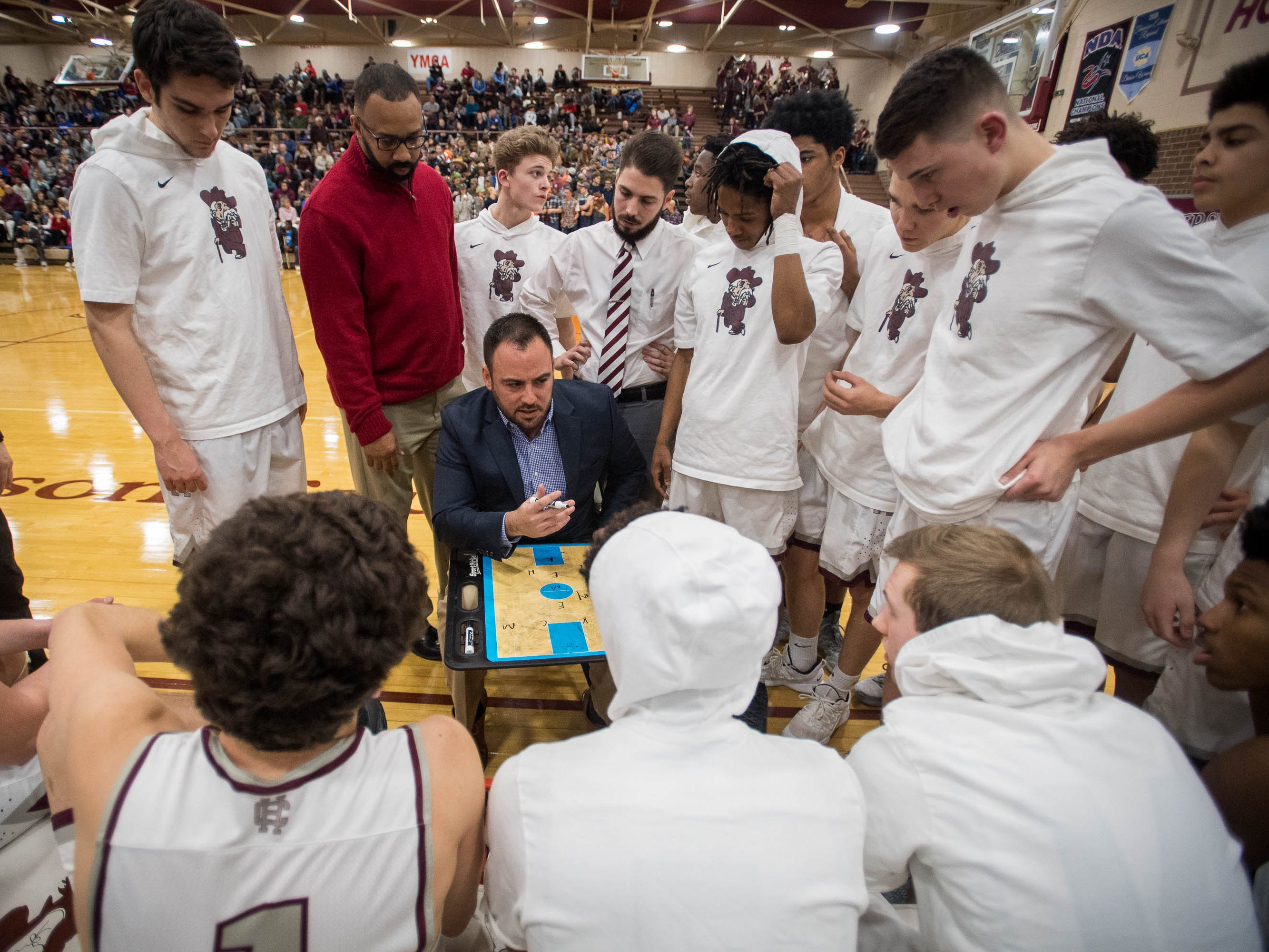 Henderson Head Coach Tyler Smithart talks to his team before tipoff as district rivals Union County Braves play the Henderson County Colonels at Colonel Gym in Henderson Tuesday, January 29, 2019.