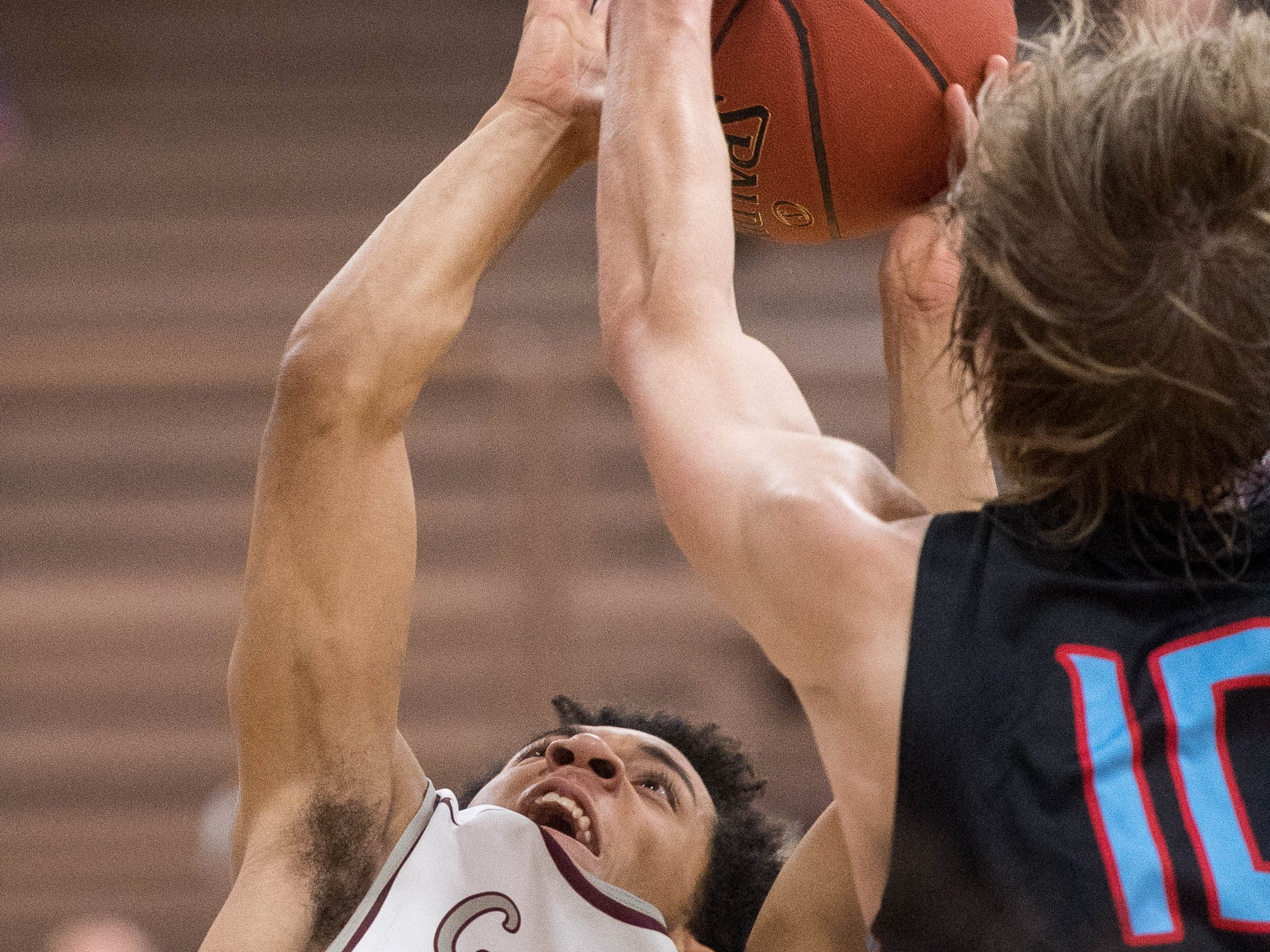 Union County's Cade Duncan (10) tries to block a layup from Henderson's Edmund Brooks (5) as district rivals Union County Braves play the Henderson County Colonels at Colonel Gym in Henderson Tuesday, January 29, 2019.