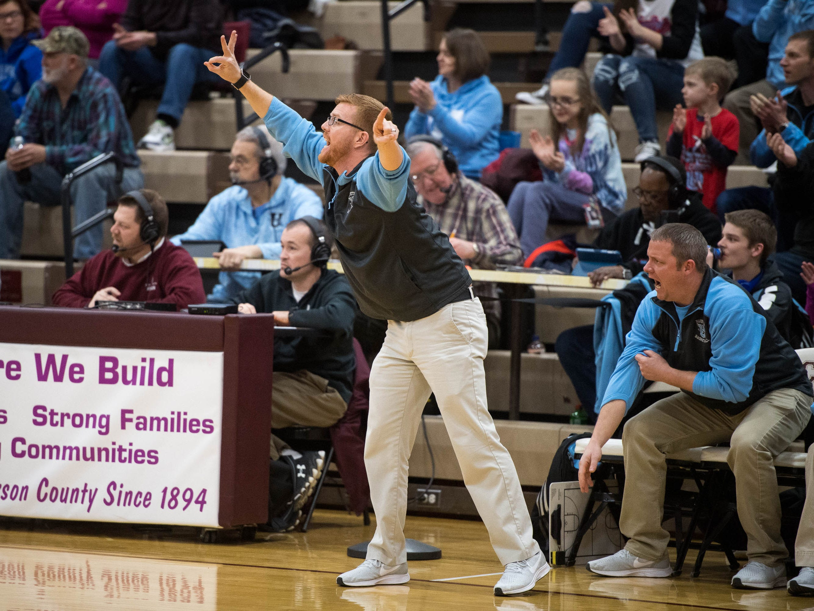 Union County head coach Derek Phillips instructs his team from the sideline as district rivals Union County Bravettes play the Henderson County Lady Colonels at Colonel Gym in Henderson Tuesday, January 29, 2019.
