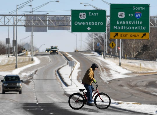 A bicycle rider crosses North Green Street in Henderson as a polar vortex descends on the area dropping temperatures to near zero with wind chills of approaching 20 degrees below Wednesday, January 30, 2019.