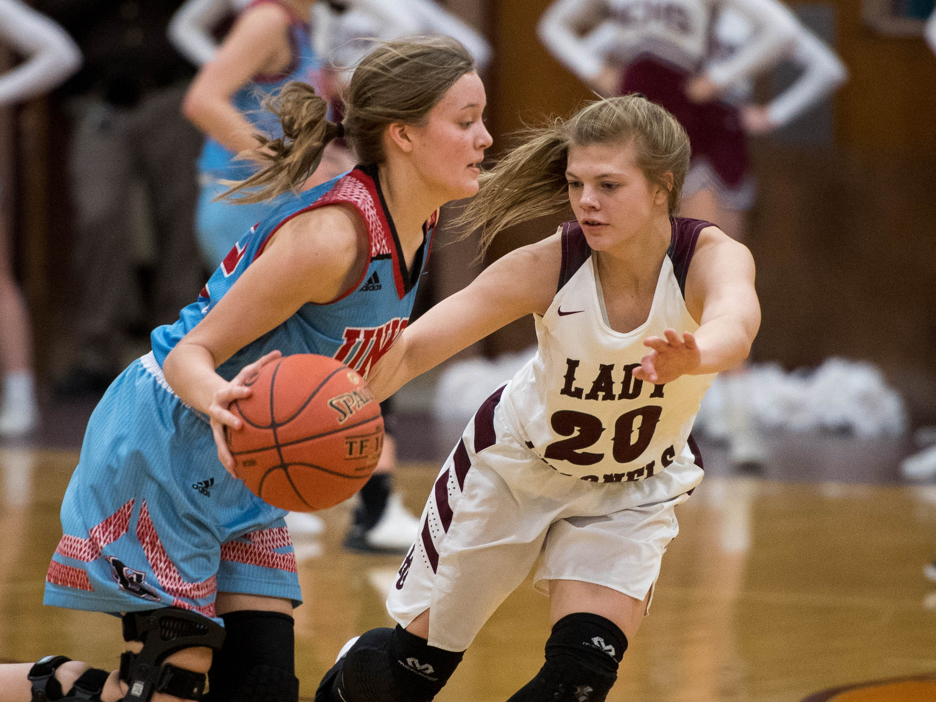 Raelle Beaven (12) drives against defense from Henderson County's Kaytlan Kemp (20) as district rivals Union County Bravettes play the Henderson County Lady Colonels at Colonel Gym in Henderson Tuesday, January 29, 2019.