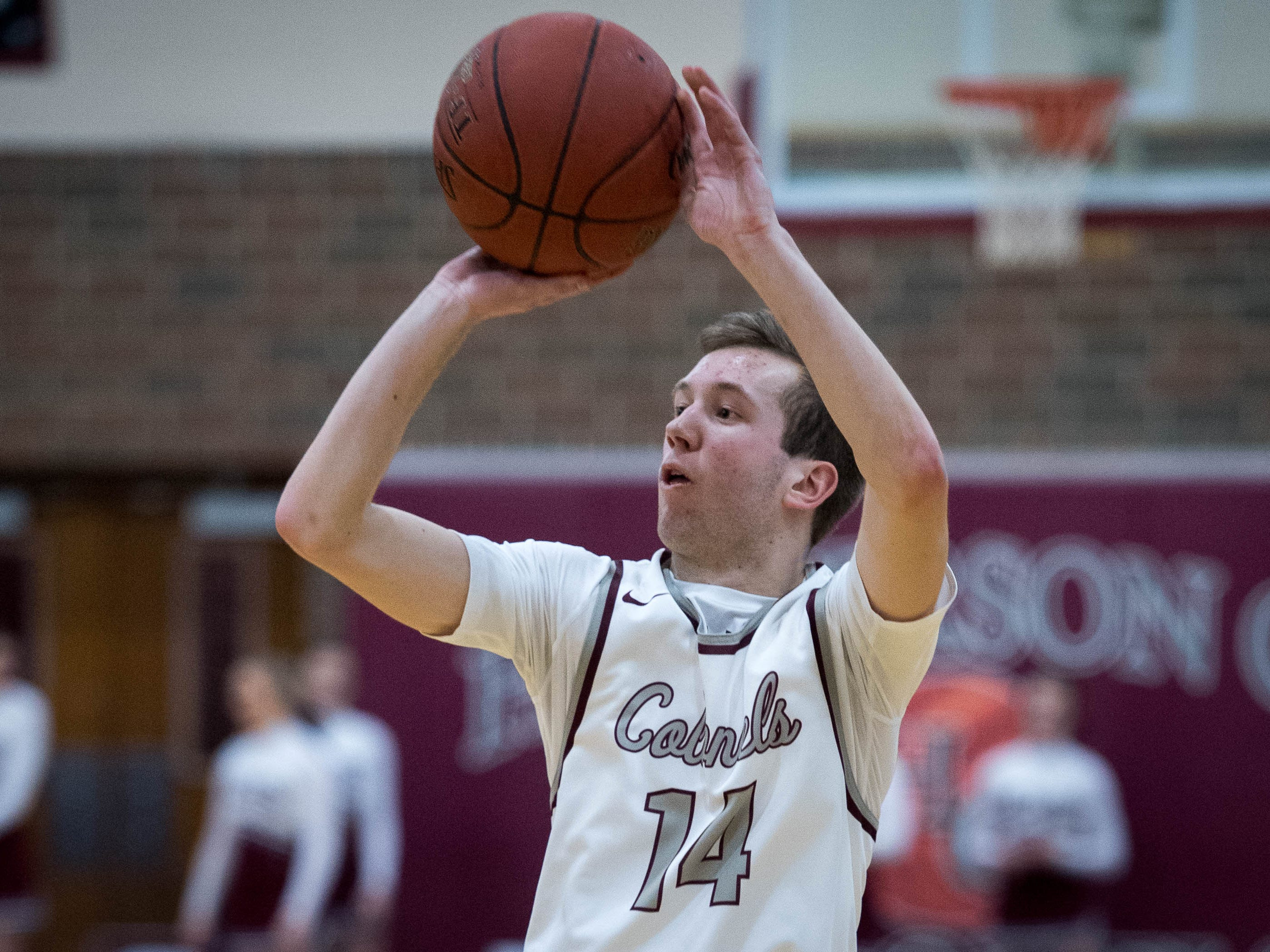 Henderson's Holden Raley (14) shoot behind the three point line as district rivals Union County Braves play the Henderson County Colonels at Colonel Gym in Henderson Tuesday, January 29, 2019.