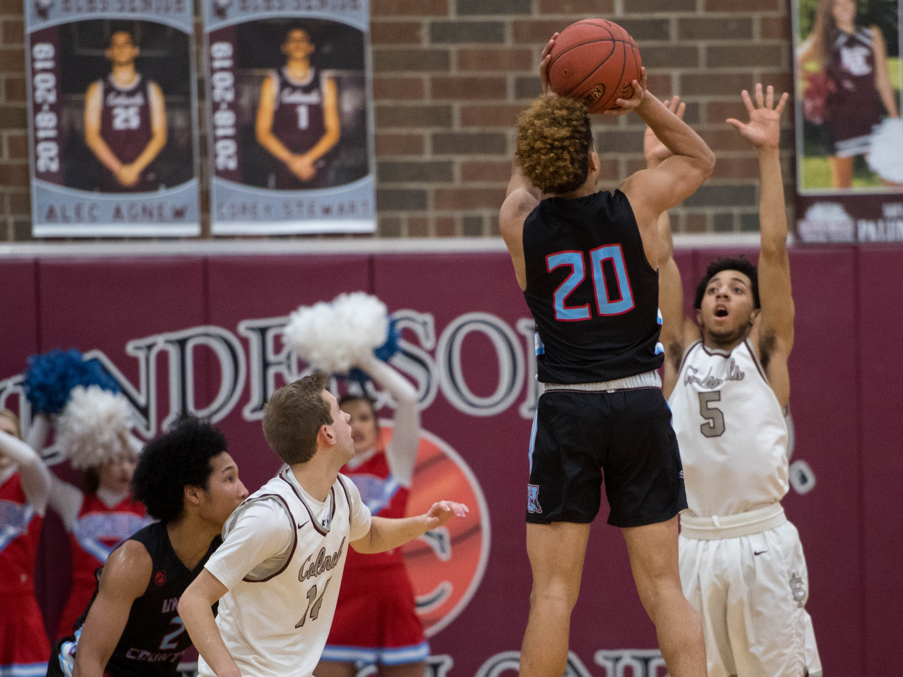 Union County's Kale Gaither (20) shoots over Henderson's Edmund Brooks (5) as district rivals Union County Braves play the Henderson County Colonels at Colonel Gym in Henderson Tuesday, January 29, 2019.