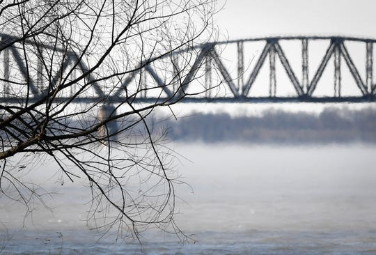 The Henderson CSX railroad bridge is obscured by steam and warm air rising above the Ohio River as a polar vortex descends on the area dropping temperatures to near zero with wind chills of approaching 20 degrees below Wednesday, January 30, 2019.