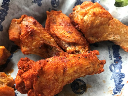 Trek to Bloomington for award-winning wings at BuffaLouie's, which USA Today named one of America's top wing joints.