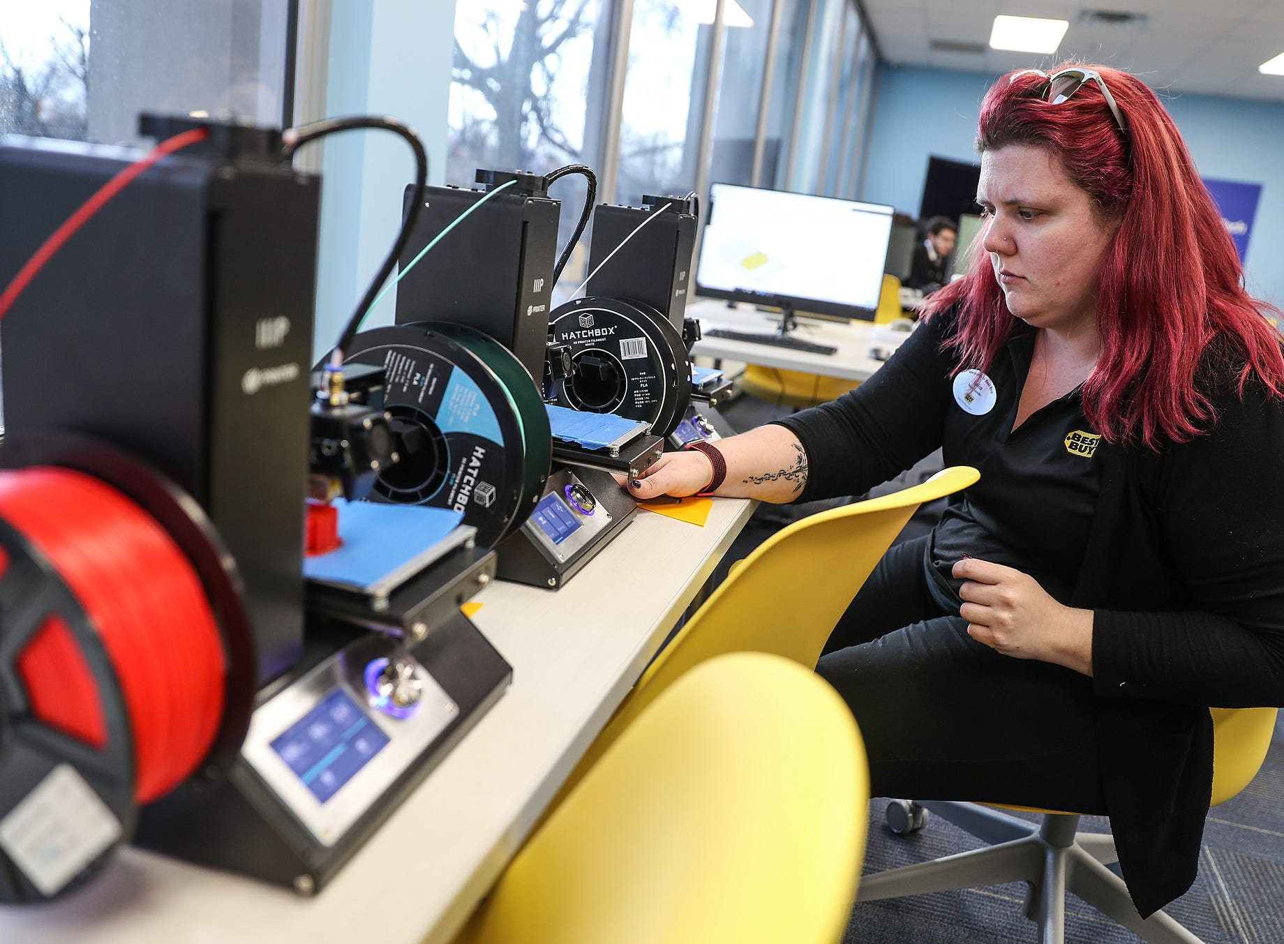 Lelia Pettigrew, from Best Buy, runs a 3-D printer during the opening of the Best Buy Teen Tech Center at the MLK Community Center in Indianapolis, Tuesday, Jan. 29, 2019.