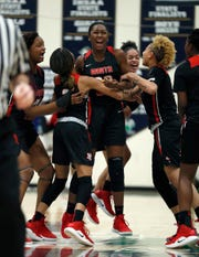 The North Central Panthers celebrate defeating the Warren Central Warriors 41-39 in their sectional basketball game at Cathedral High School on Tuesday, Jan. 29, 2019.