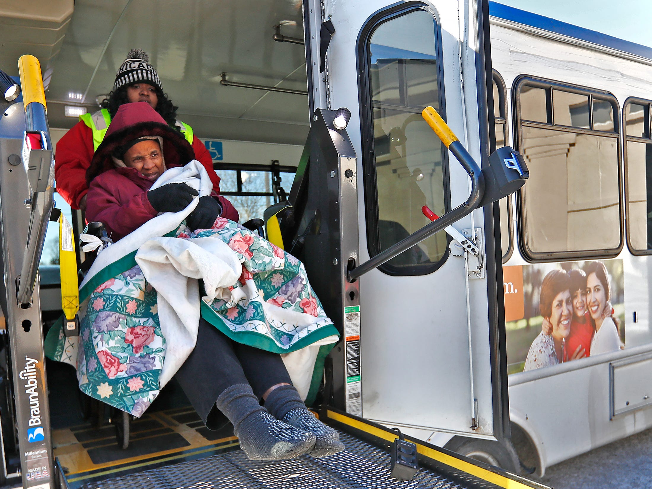Tara Drain is wheeled out of the bus by Dee Francis, with IndyGo, to go into a Community Emergency Response Team warming center at the Municipal Gardens, 1831 Lafayette Rd., Wednesday, Jan. 30, 2019.  Drain was coming in out of the cold, as she doesn't have a home.  Wind chills made it feel like almost 30 below zero.