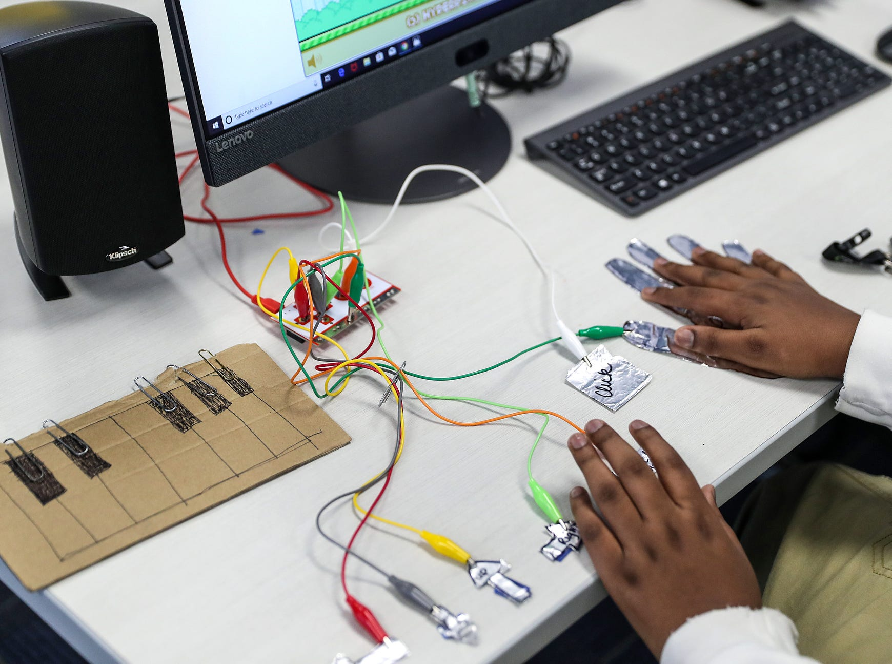 One station at the new Best Buy Teen Tech Center lets the user to use circuits to turn everyday objects into a game controller, at the MLK Community Center in Indianapolis, Tuesday, Jan. 29, 2019.