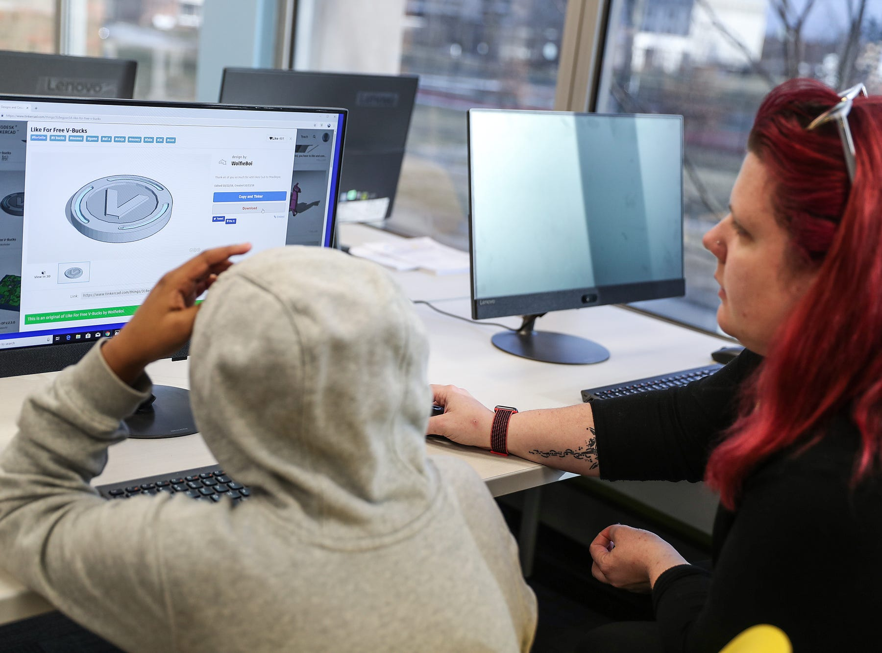 From right, Lelia Pettigrew helps Luke Grady, 13, print a 3-D design during the opening of the Best Buy Teen Tech Center at the MLK Community Center in Indianapolis, Tuesday, Jan. 29, 2019.