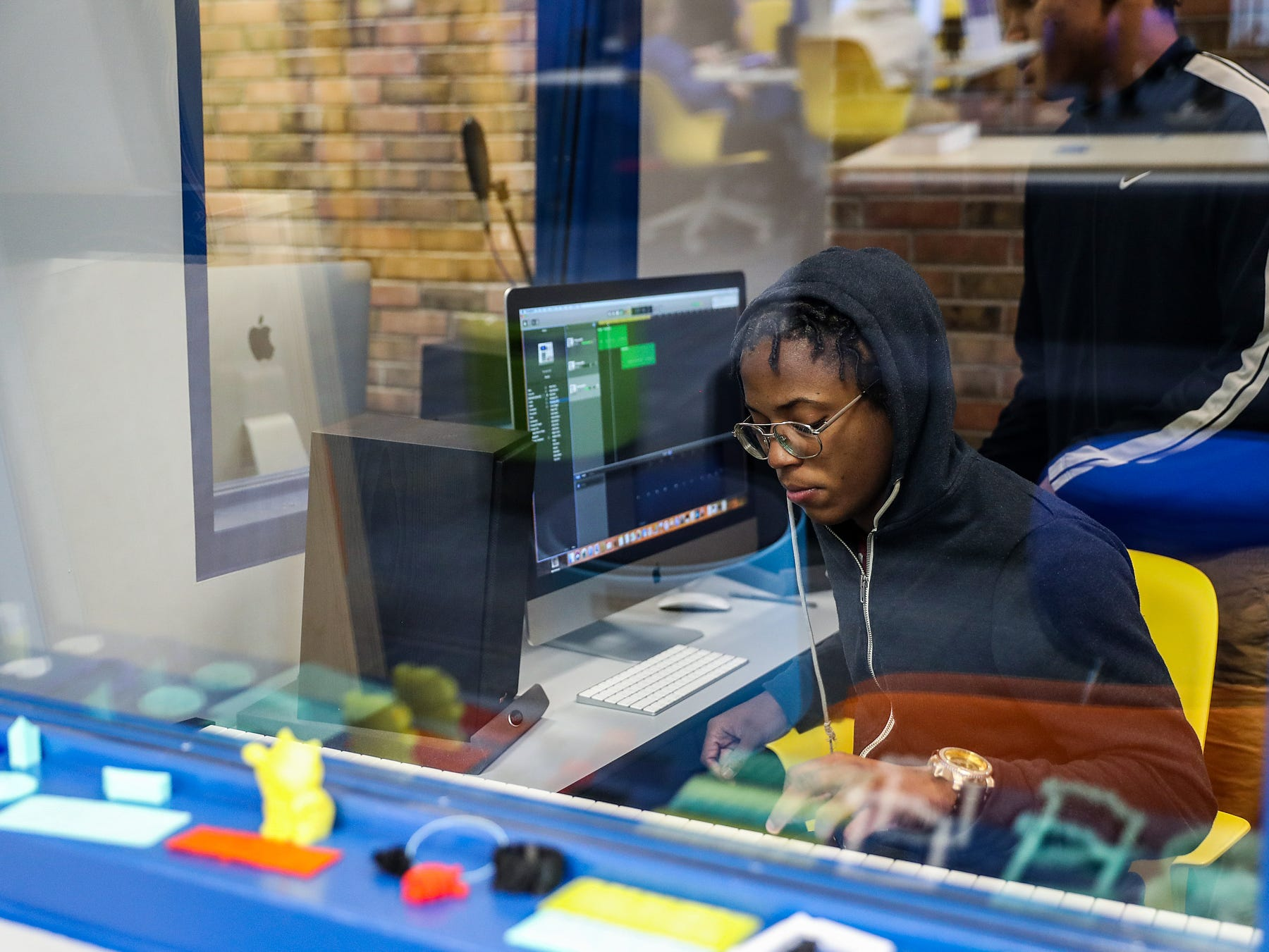 Jowan Easton, 15, pictured in front, works with Markell Smith, 14, in a recording booth during the opening of the Best Buy Teen Tech Center at the MLK Community Center in Indianapolis, Tuesday, Jan. 29, 2019.