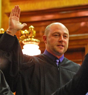 Hendricks County Judge Robert Freese administering the Oath of Office to a Lincoln Township Board Member in 2007.