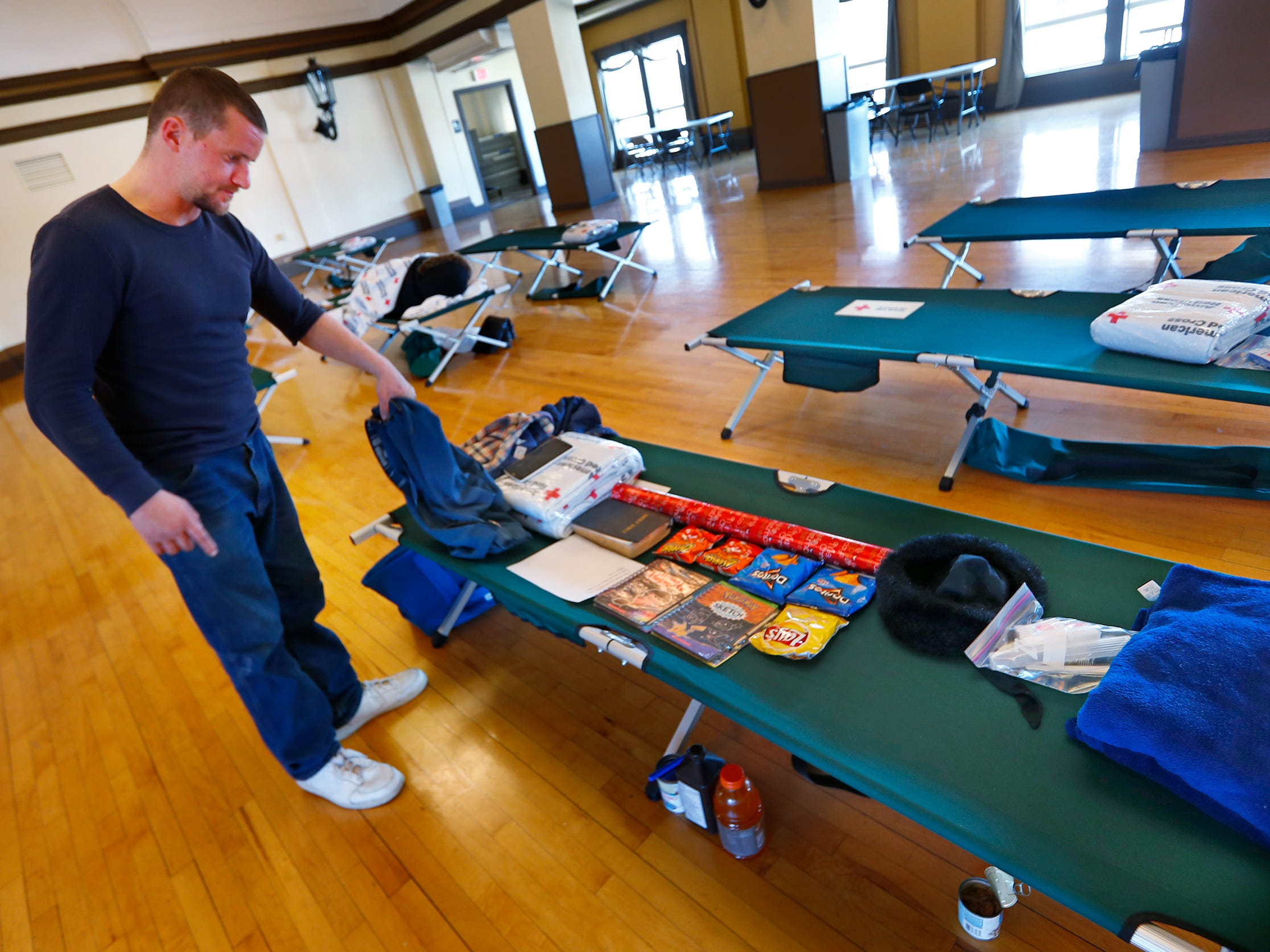 Chris Smith arranges his things on a cot at a Community Emergency Response Team warming center at the Municipal Gardens, 1831 Lafayette Rd., Wednesday, Jan. 30, 2019.  Wind chills made it feel like almost 30 below zero.