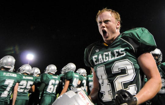 Zionsville's Blake Lueders (42) celebrates as the end of the game nears. against Fishers October 2, 2009.