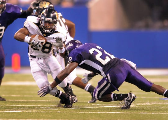 Ben Davis's Isaiah Lewis (#22) goes in for  a tackle against Warren Central in 2009.