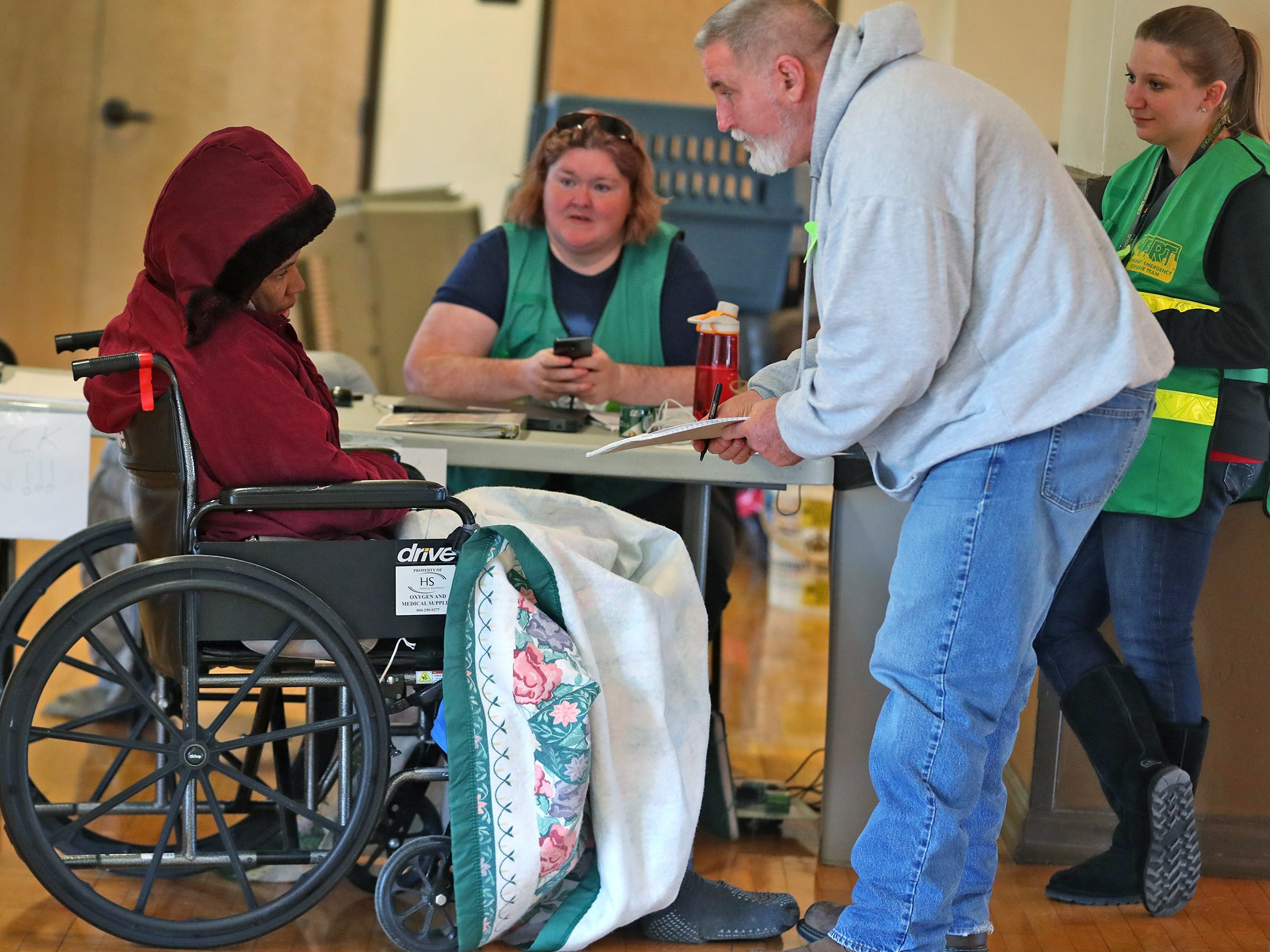 CERT volunteer James Schutte, right, checks in Tara Drain, left, to a Community Emergency Response Team warming center at the Municipal Gardens, 1831 Lafayette Rd., Wednesday, Jan. 30, 2019.  Wind chills made it feel like almost 30 below zero.