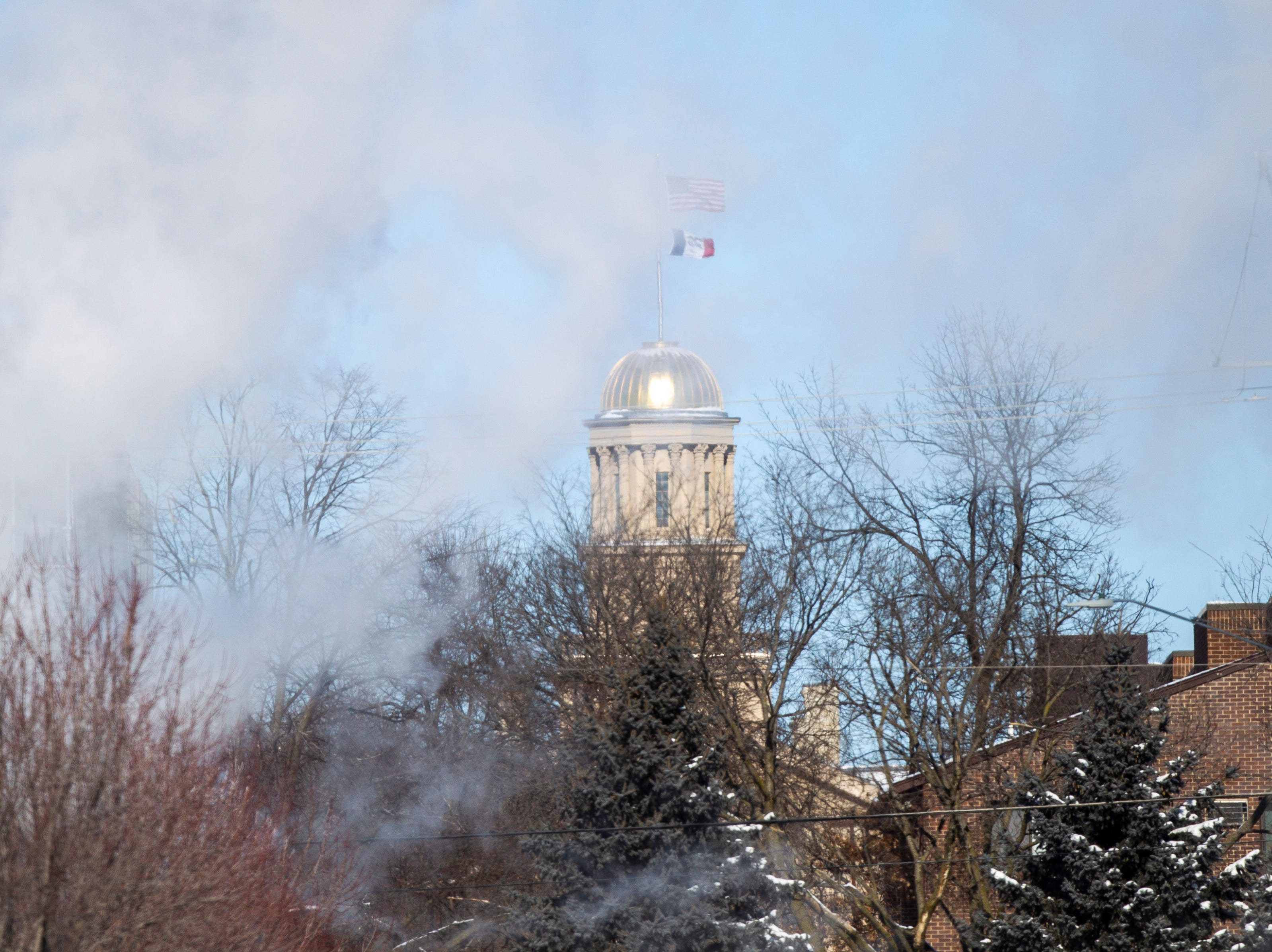 Steam flows through the frigid air in front of the Old Capitol Building on Wednesday, Jan. 30, 2019, along Capitol Street in Iowa City, Iowa.
