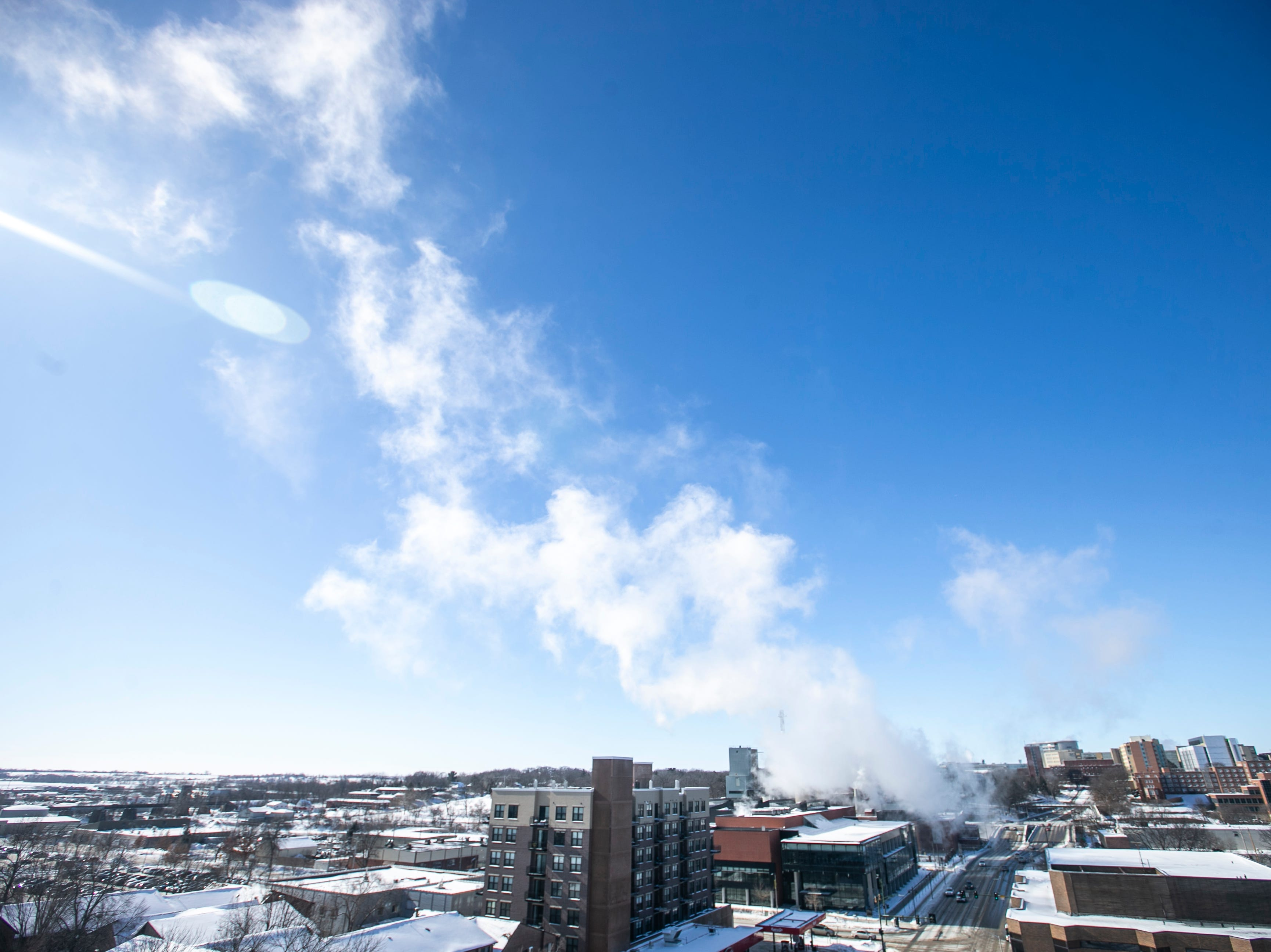 Steam flows out of the UI Power Plant on Wednesday, Jan. 30, 2019, shown from the top of a parking ramp on the corner of Capitol and Burlington Streets in Iowa City, Iowa.