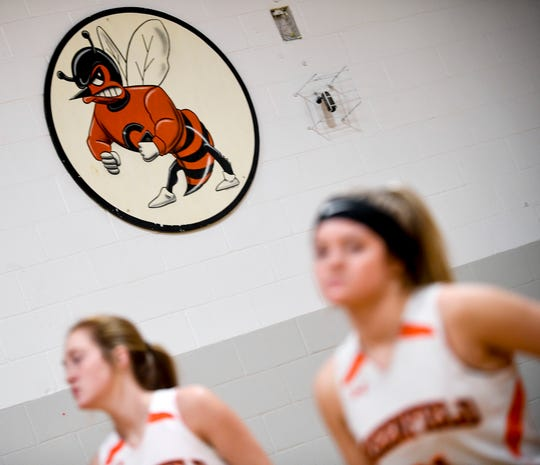 The logo for the Greenfield Yellowjackets can be seen on the wall of an older gym above players in an afternoon practice at Greenfield School in Greenfield, Tenn., on Thursday, Jan. 24, 2019.