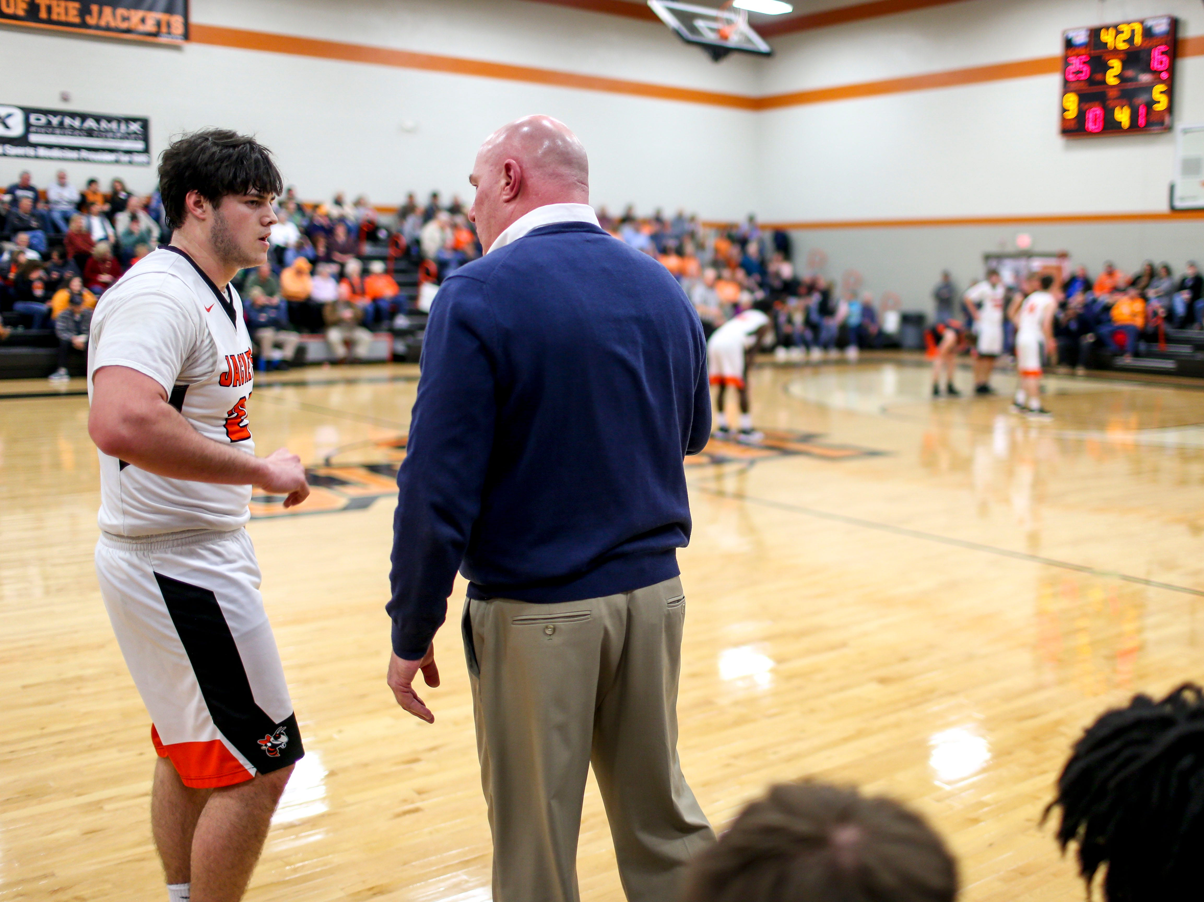 Greenfield's Jackson Crouse (20) speaks with his head coach during a TSSAA basketball game between Greenfield and Gleason at Greenfield School in Greenfield, Tenn., on Friday, Jan. 25, 2019.