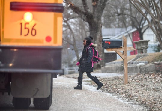 A Jackson-Madison County school bus picks up students on its way to Alexander Elementary on Jan. 30, 2019.