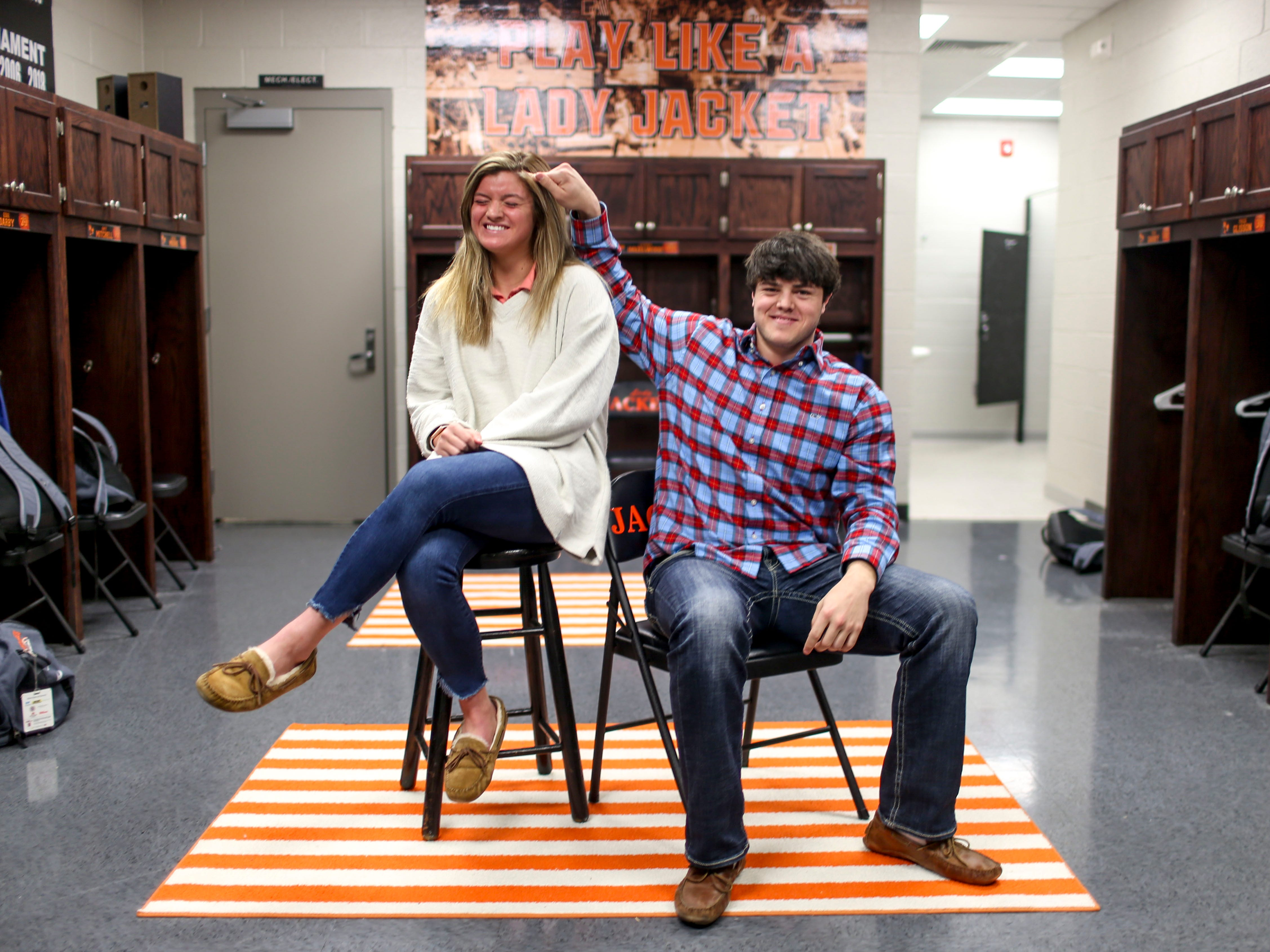 Caroline Crouse, left, and Jackson Crouse, right, siblings that both play on their respective varsity basketball teams and have had cochlear implants since a young age, sit for a portrait together in the locker room at Greenfield School in Greenfield, Tenn., on Thursday, Jan. 24, 2019.
