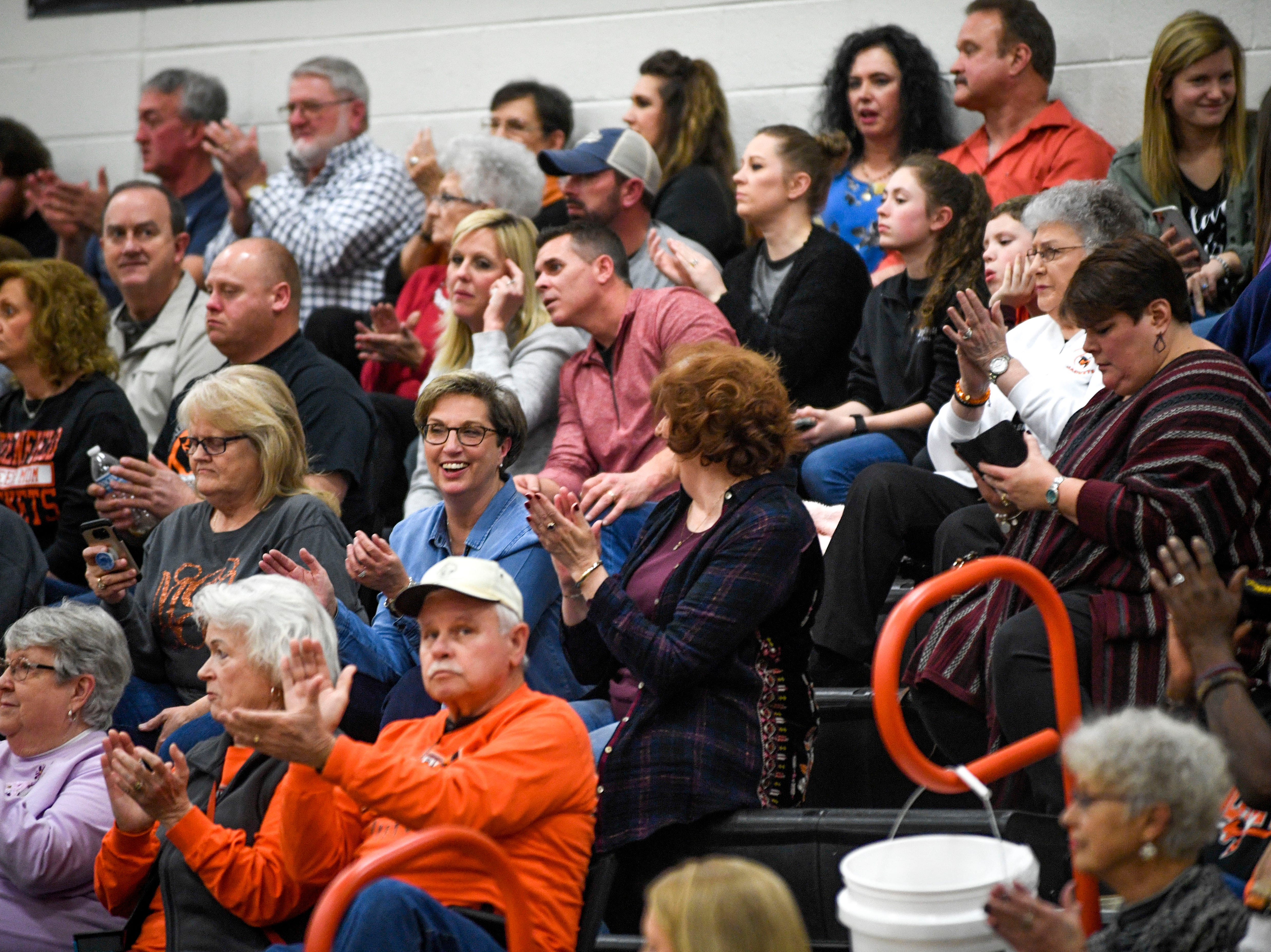 Greenfield fans clap for their team in a TSSAA basketball game between Greenfield and Greason at Greenfield School in Greenfield, Tenn., on Friday, Jan. 25, 2019.