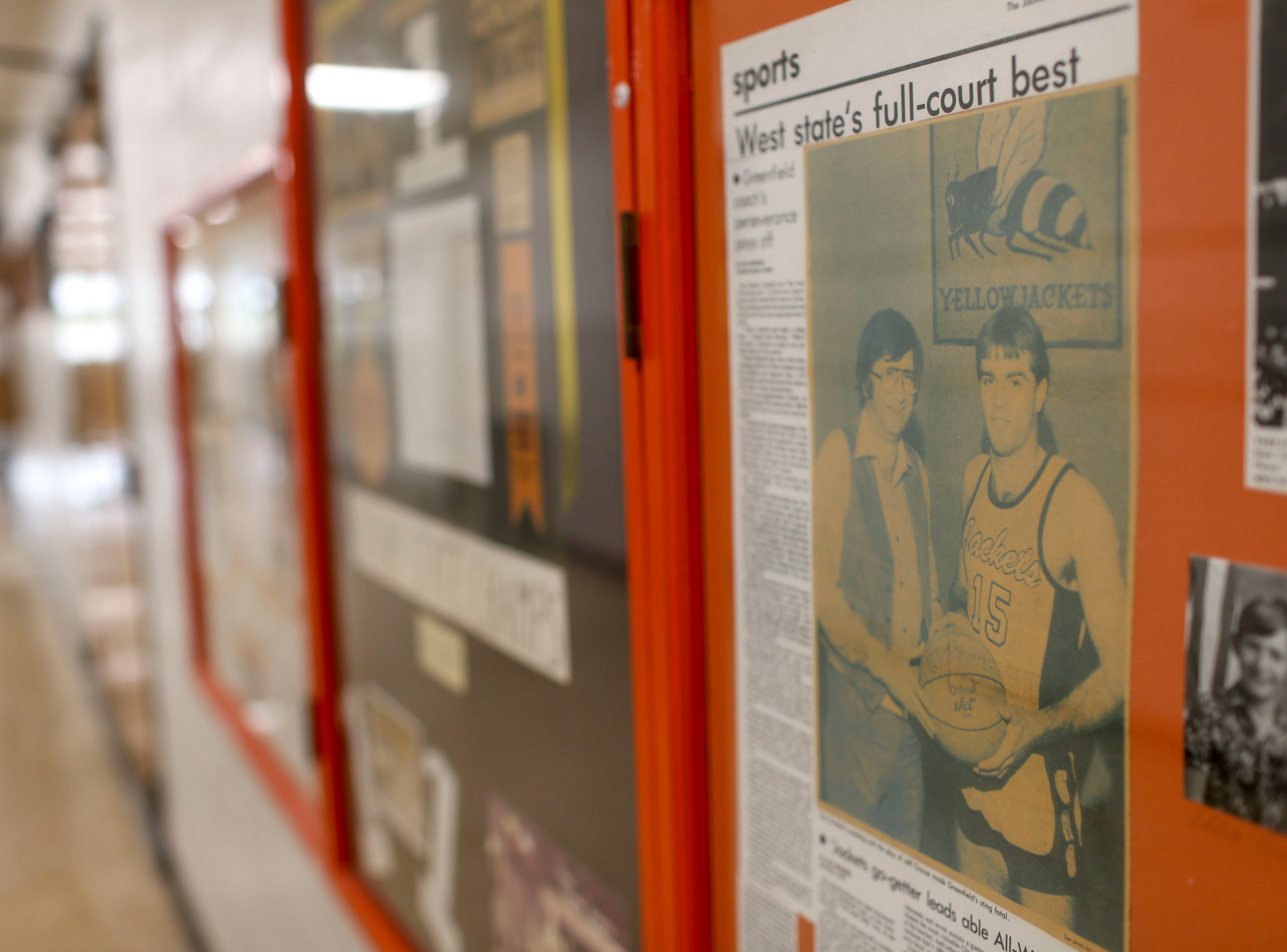 A framed news article and photo featuring the Crouse sibling's uncle Jeff Crouse, who played on a state championship team, can be seen hung on the wall at Greenfield School in Greenfield, Tenn., on Thursday, Jan. 24, 2019.