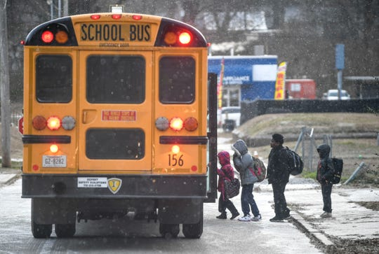 A Jackson-Madison County school bus picks up students on its way to Alexander Elementary during a polar vortex that hit Jackson mildly compared to spots across the United States at Campbell Street in Jackson, Tenn., on Wednesday, Jan. 30, 2019.