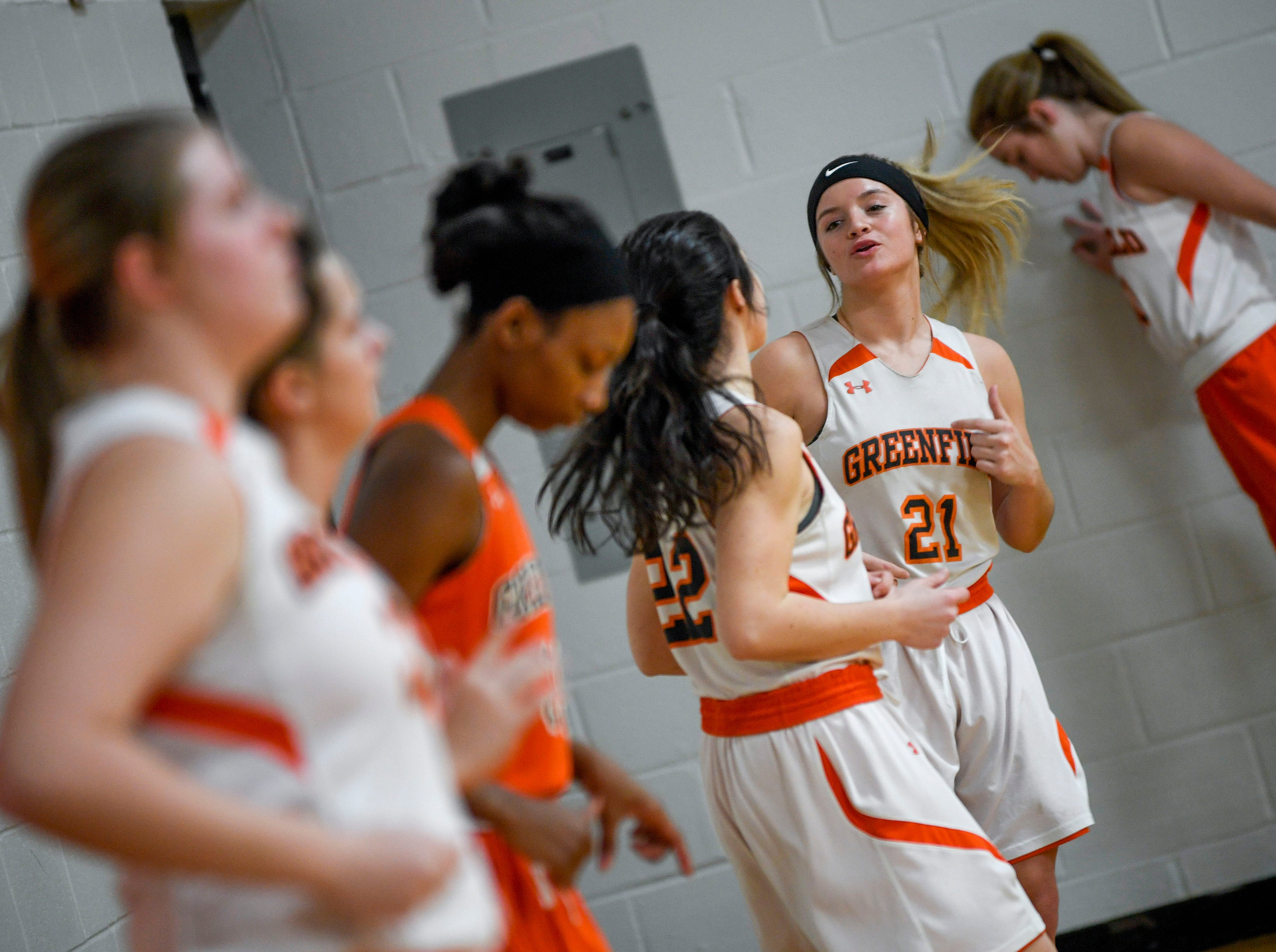 Caroline Crouse (21) talks with teammates during an afternoon practice at Greenfield School in Greenfield, Tenn., on Thursday, Jan. 24, 2019.