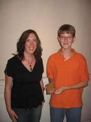 """Sam Shadwell receives the """"Advance Award,"""" given by each faculty member to their outstanding student of the year, from his teacher Sarah Pirkle at CSA's Spring Recital, May 28, 2008."""